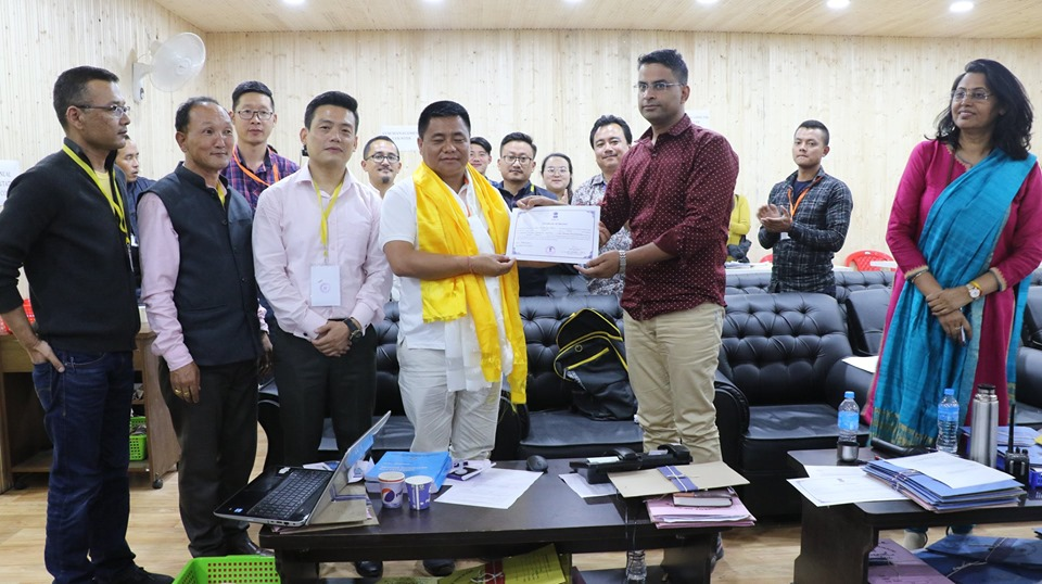 Shri Pintso Namgyal Lepcha, (winner) SDF candidate from 30-Dzongu receiving election certificate from DEO, North